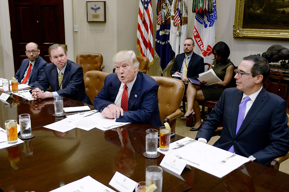 President Trump discusses the Federal budget in the Roosevelt Room of the White House. OMB director Mick Mulvaney sits to the President's right and Treasury Secretary Steven Mnuchin sits to his left.