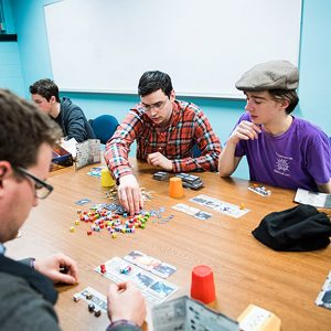 Students  in the BU Board Games Club playing strategy board games