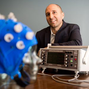 Prof Rob Reinhart has a new paper coming out in PNAS.  In his research, he has been able can up-regulate or down-regulate cognitive performance via non-invasive brain stimulation in health humans. Pictured here with some equipment including a high definition cranial electrical current stimulator.Prof Rob Reinhart has a new paper coming out in PNAS.  In his research, he has been able can up-regulate or down-regulate cognitive performance via non-invasive brain stimulation in health humans. Pictured here with some equipment including a high definition cranial electrical current stimulator.