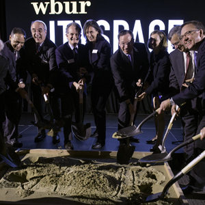 Lead funders for WBUR's CitySpace dig their shovels into a pit of sand during the ground breaking ceremony and celebration of the upcoming, state-of-the-art multimedia venue.