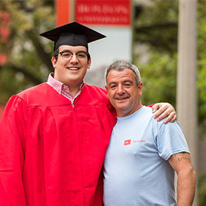 Boston University Class of 2018 Graduate Andrew Almeida with Father Eddie Almeida
