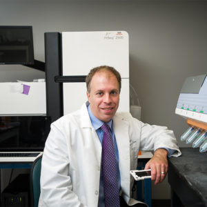 Avrum Spira, a School of Medicine professor of medicine, pathology, and bioinformatics, and a pioneering researcher in the genomics and early detection of lung cancer, will direct the new Johnson & Johnson Innovation Lung Cancer Center at Boston University. Photo by Cydney Scott