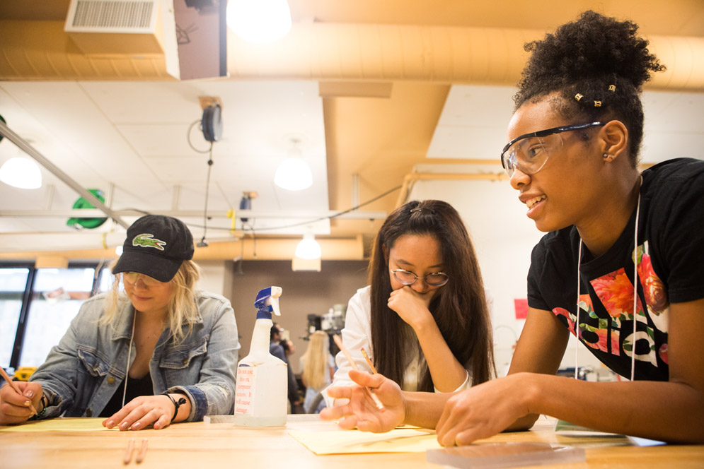 Team One's Sophia Crandall (Questrom'19) (from left), Moyan Xu (Questrom'20), and Leah Fowlkes (Questrom'20) sketch up a plan for their tower.