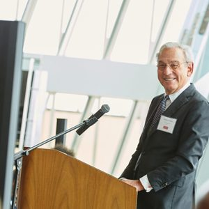Boston University trustee Richard D. Cohen smiles as he speaks to a crowd at the Cohen Scholar Reception.