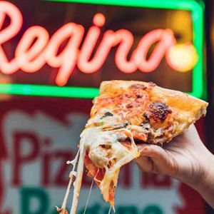 A cheesy slice of pizza from Regina Pizzeria