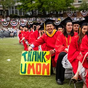 A graduate of the Boston University Class of 2019 celebrates after graduating at the 146th All University Commencement.