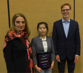Translational Research Symposium co-chiars Gabriela Apiou (far left) and Bruce Tromberg (far right) present the Translational Research Best Paper Award to Boston University's Pu-Ting Dong (center)