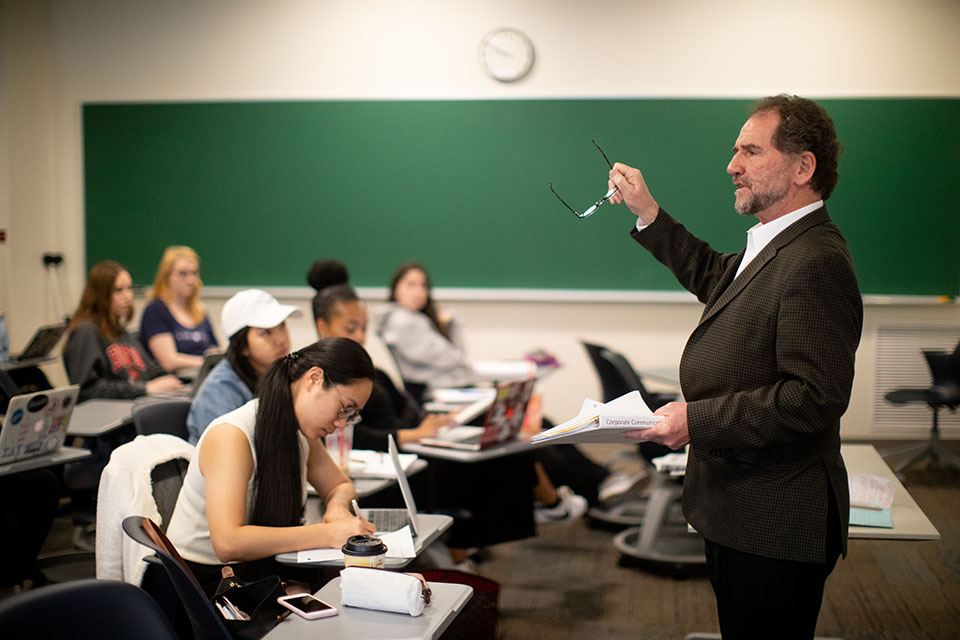 Prof. Stephen Quigley gestures during a lecture.