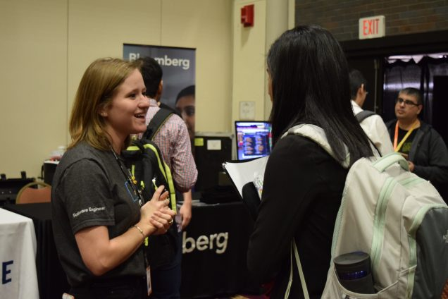A student meets with a Bloomberg employee to discuss career opportunities.