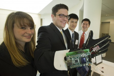 Members of Team GloveSense, Anna Evans (pictured from left), Luke Anderson, Jonathan Kwan, and Angelo Luo, demonstrate their smart glove for first responder communication.