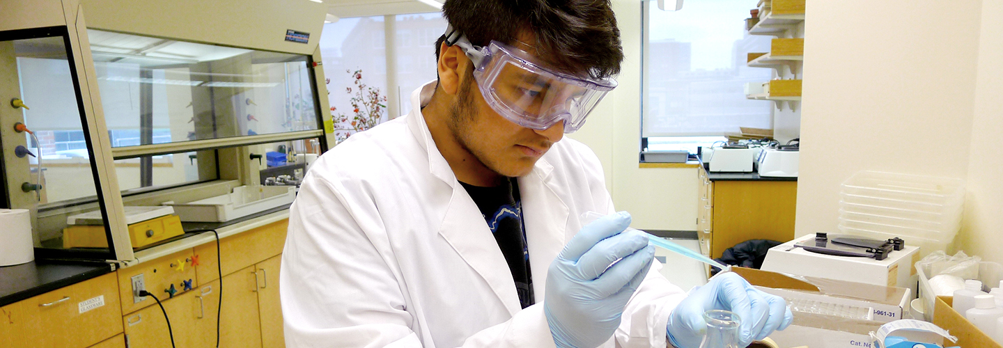 boston university engineering student using pipette