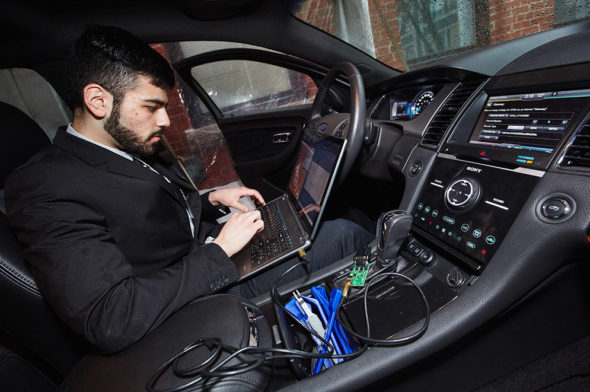 Omar Janoudi (ENG'17) of Team 2 uses the group's AutoPen software to hack into the computer systems of a Ford Taurus at ECE Day.