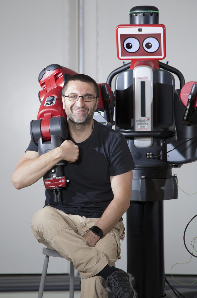 Professor Calin Belta (ME, SE, ECE) with Baxter robot at EPIC. Photo by Dana Smith for Boston University Photography