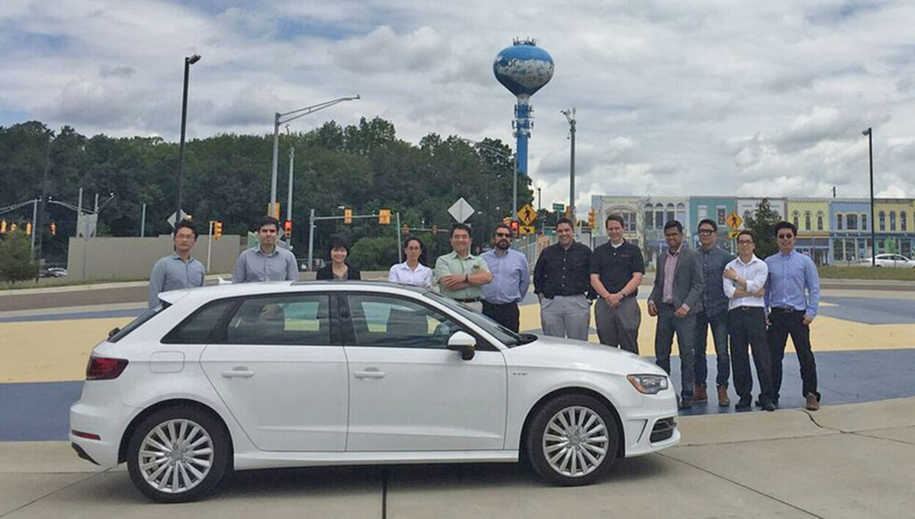 Professor Christos Cassandras (ECE, SE) and research team members from a collaborative grant awarded by the Energy Department's Advanced Research Projects Agency-Energy NEXTCAR program display the vehicle they will turn into an autonomous smart car. Image provided by Cassandras