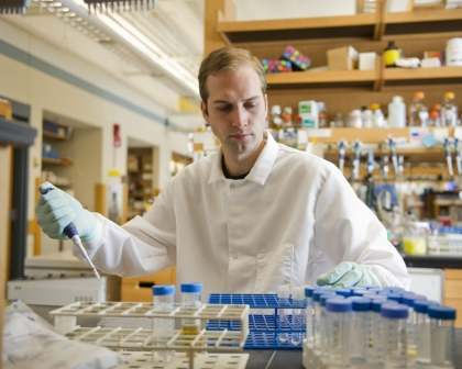 Kyle Allison, winner of the top graduate prize in the Collegiate Inventors Competition, at work on persistent bacteria in the Collins Lab. (Photo by Cydney Scott)