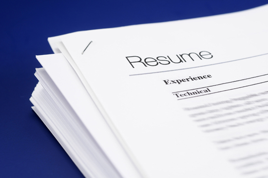 A stack of generic resumes sitting on a desk