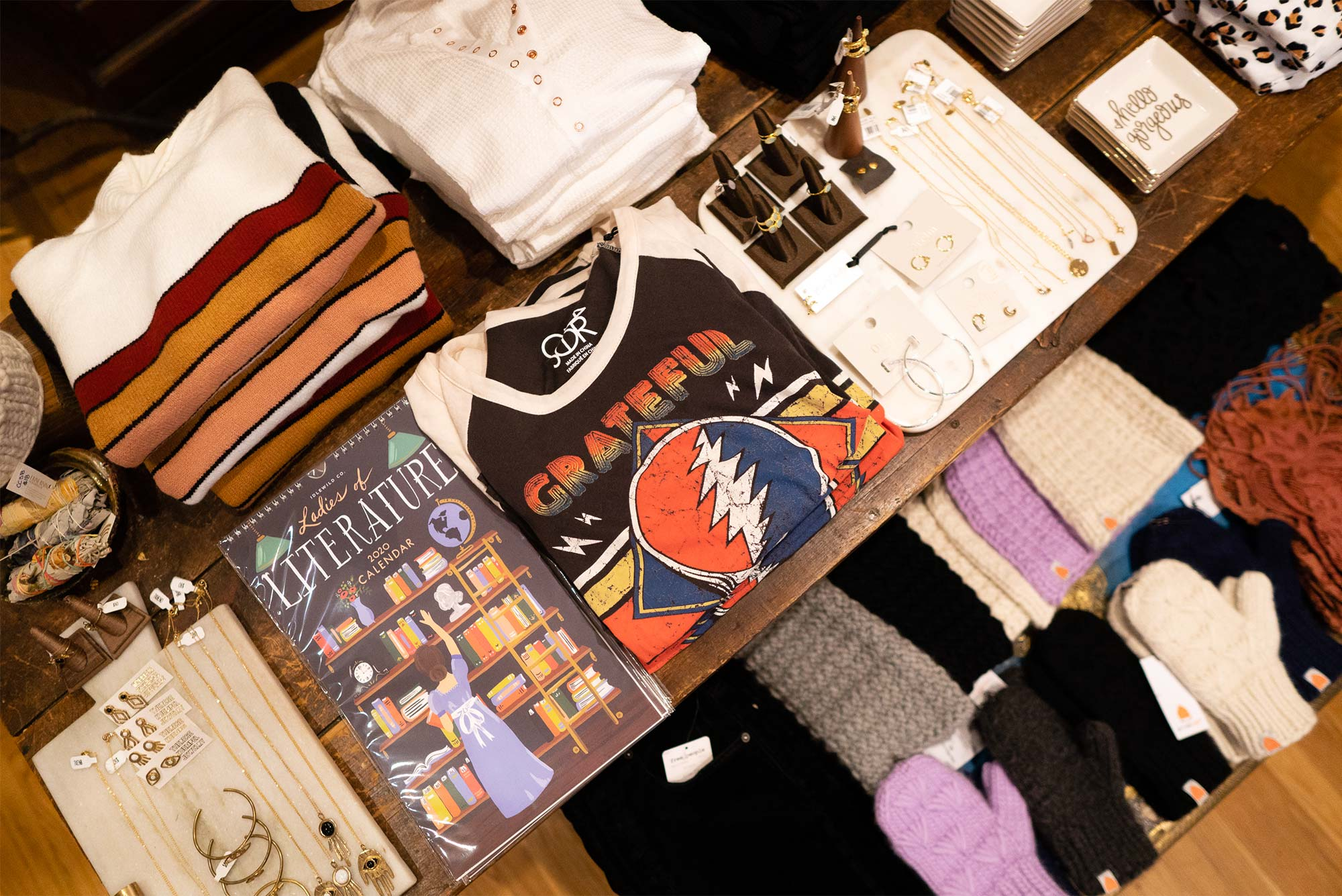 Products, including jewelry and shirts, are displayed on a table in the store Flock located in Boston's South End neighborhood.