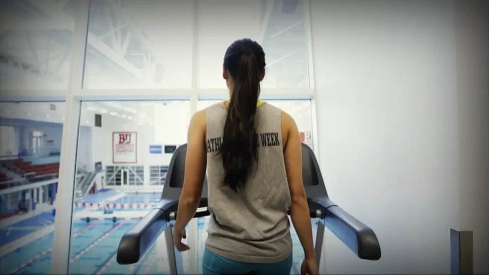 view from behind a person walking on a treadmill