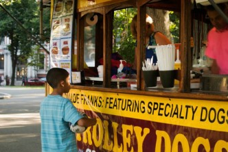 Boy ordering from Trolley Dogs food truck