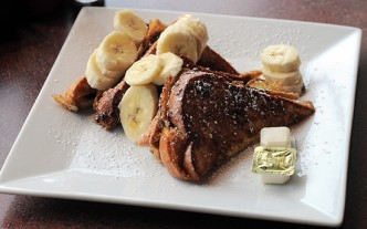 The challah Nutella-stuffed French toast with bananas makes a perfect light entrée.