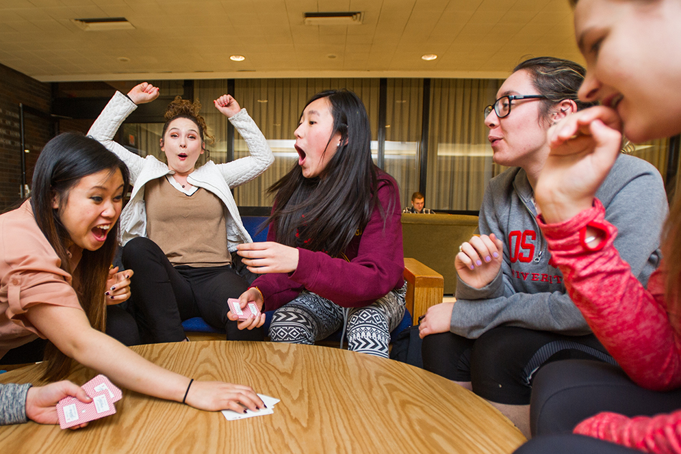 "Alpha Phi Omega ""brothers"" Jessie Leafmeeker (SED'17) from left, Rebecca Barton (SED'18), Diana Parker (COM'18), Emily Hou (CAS'17), Michelle Grbic (SAR'16) and Sarah Eldredge (CAS'17) get competitive with a game of Egyptian Ratscrew at the GSU's Ziskind Lounge February 24, 2016. Photo by Cydney Scott"