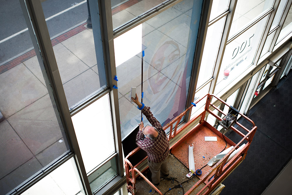 New art created by Yue Guan (CAS'16, COM'16) is installed by Seaport Graphics at Warren Towers on Monday, May 9, 2016.