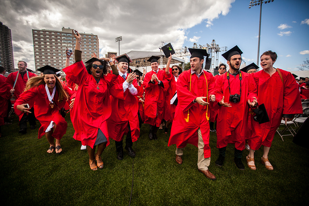 Members of the Class of 2016 celebrate following the close of Boston University's 143rd Commencement