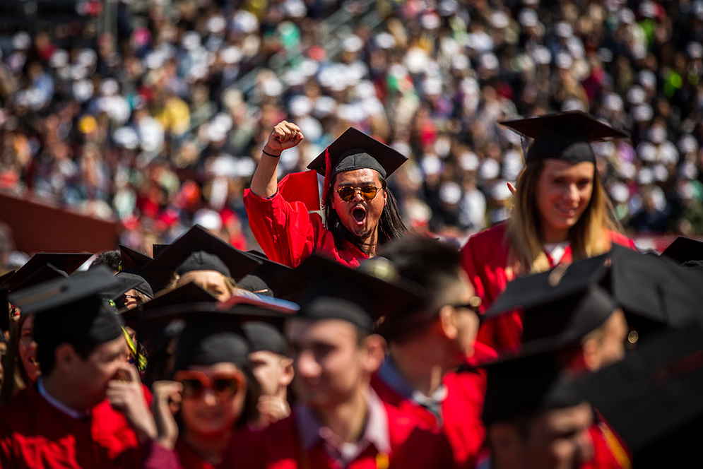 Graduate Allan Chen pumps his fist in excitement during Boston University's 143rd Commencement