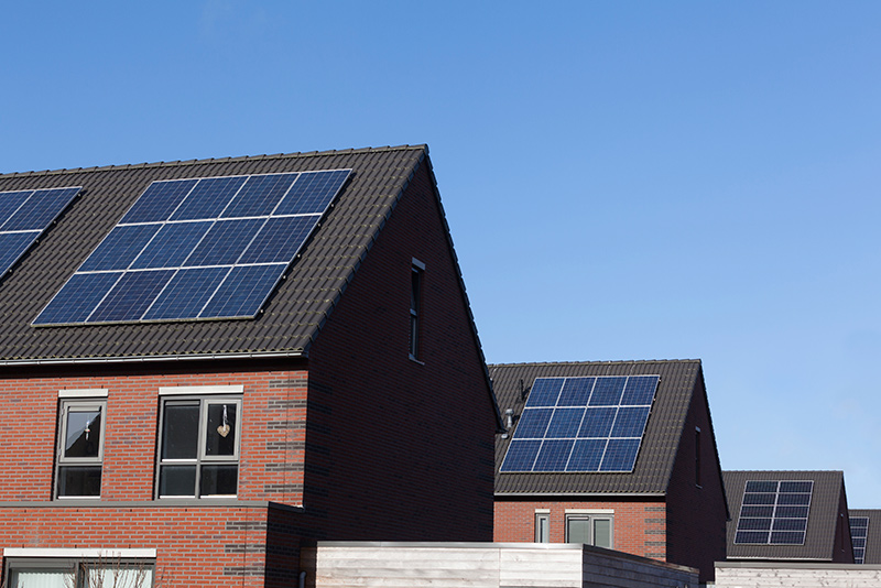 mulitple homes with rooftop solar arrays
