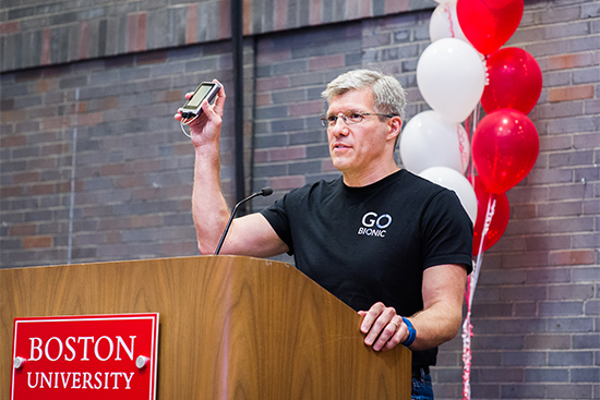 Edward Damiano holds the iLet bionic pancreas while accepting the Innovator of the Year award at the Boston University Tech, Drugs, and Rock n' Roll event