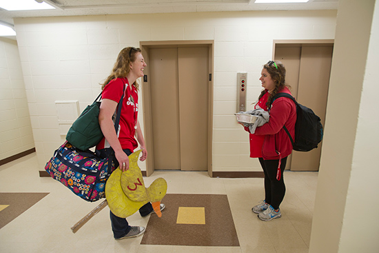 Pam Larson (SHA'15), left, and Julia case (CAS, CFA'14) outside of the elevators at Claftin Hall