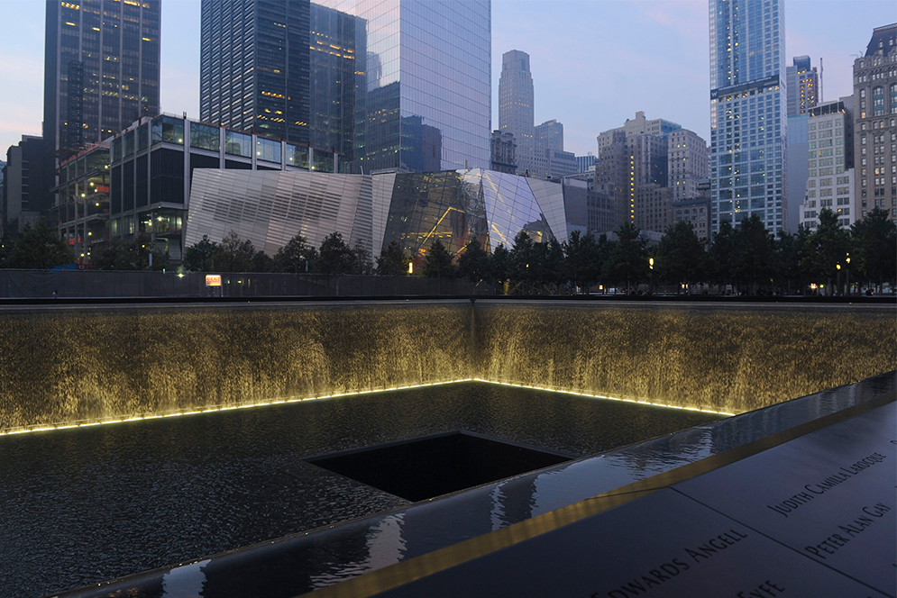 A view of 9/11 Memorial Plaza from the North Pool at night