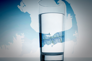 glass of drinking water in front of a map of Cape Cod, Massachusetts