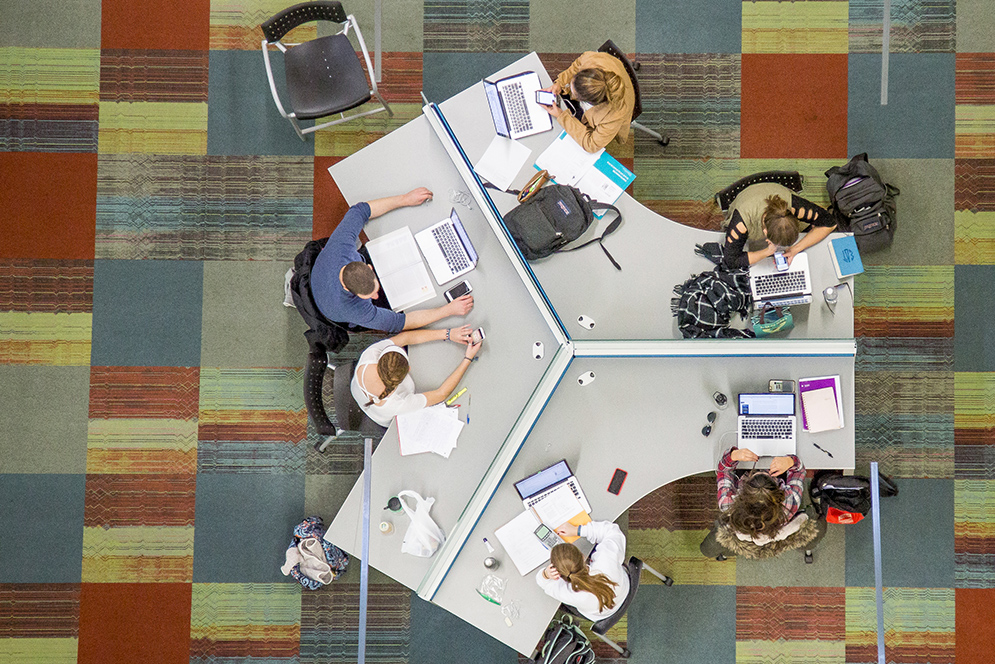 Aerial view of students studying in the Metcalf Center for Science and Engineering
