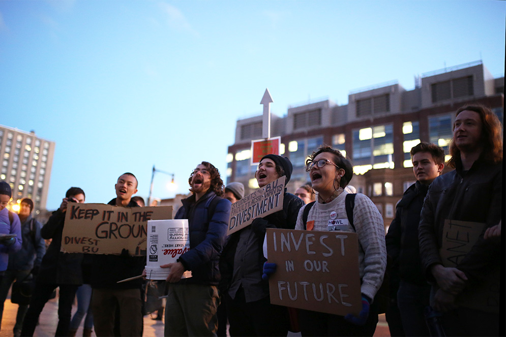 Students from the Divest BU student group rally on Marsh Plaza to urgre Boston University President Robert Brown and the BU Board of Trustees to divest the university's endowment from fossil fuel holdings