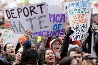 Demonstrators display pro-immigrant signs at the Boston Protest Against Muslim Ban and Anti-Immigration Orders, January 29, 2017 in Copley Square, Boston