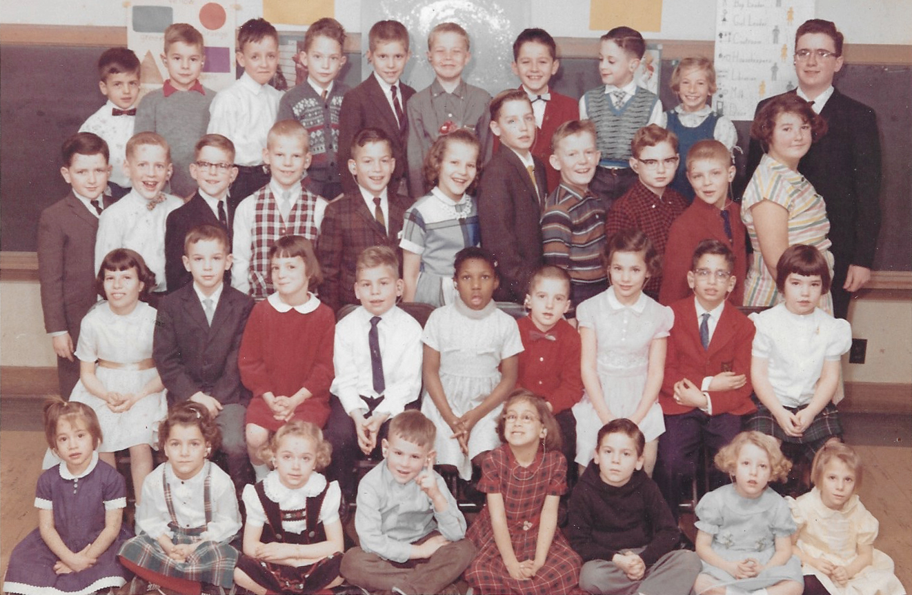 Raymond Kenney stands in the back row, far right, a bright adolescent in a class of elementary-age students. Kenney is deaf but had no access to sign language in school, so he had limited opportunities to advance.