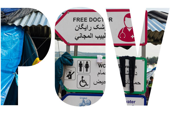 Free Doctor and Drinkable Water signs in a Syrian Refugee Camp in Eidomeni, Greece