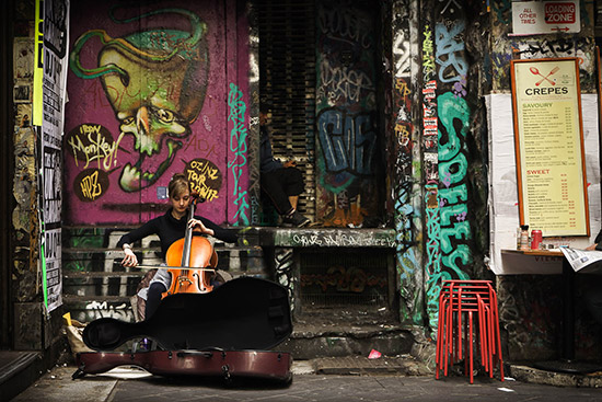 Laura Burvill took the top prize for her vibrant photograph of a cellist on a small side street in Melbourne, Australia.