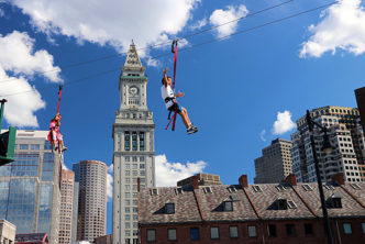Zipline riders above the Rose Kennedy Greenway