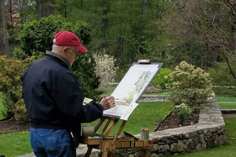 Man painting on art canvas in the outdoors