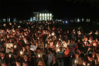 "Hundreds gathered on the University of Virginia campus for a candlelight vigil against hate and violence days after Charlottesville erupted in chaos during the ""Unite the Right"" white nationalist rally."