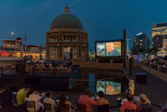 movie playing at Boston Harbor Hotel's Harborwalk Terrace