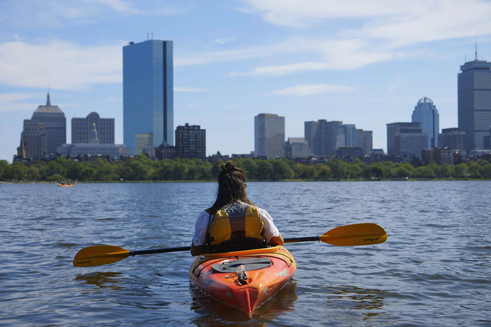 Zayas kayaking on the Charles River