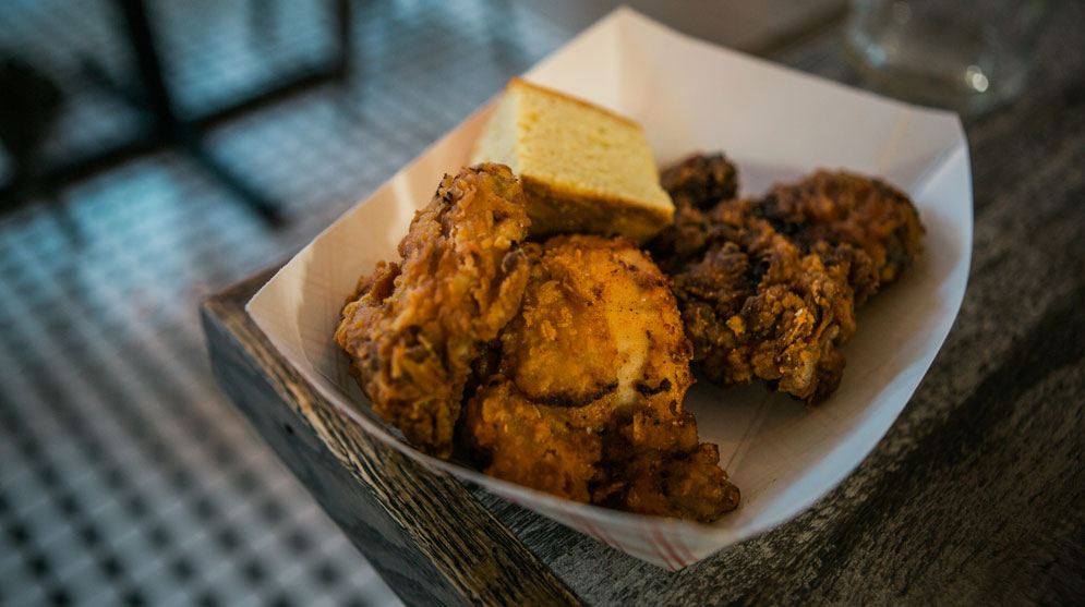 At Kitchen Sink, every Monday is fried chicken night, featuring deep-fried buttermilk-soaked chicken with pickled vegetables, cornbread, and slaw.