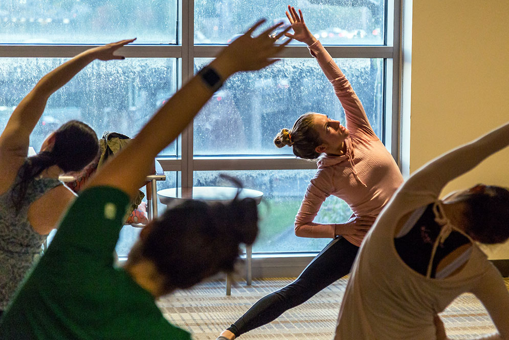 Cailey Face (SSW '17) leads Sunrise Yoga in Stuvi II. Photo by Alexandra Wimley (COM '17)