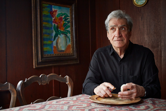 Former US poet laureate Robert Pinsky snacks on cheese
