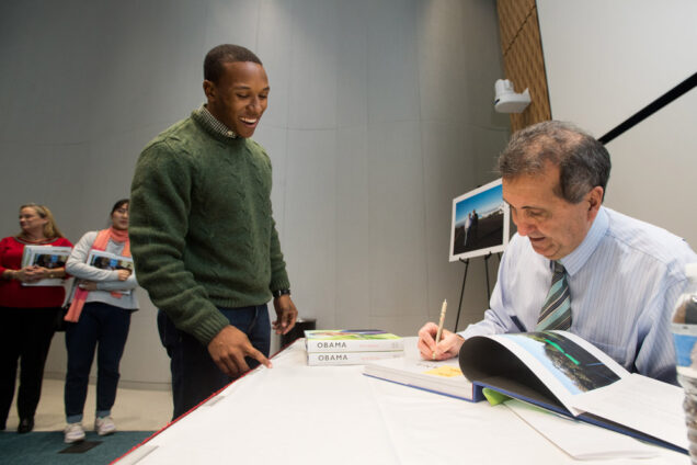 White House photographer Pete Souza (COM'76) signs copies of his book, Obama: An Intimate Portrait.
