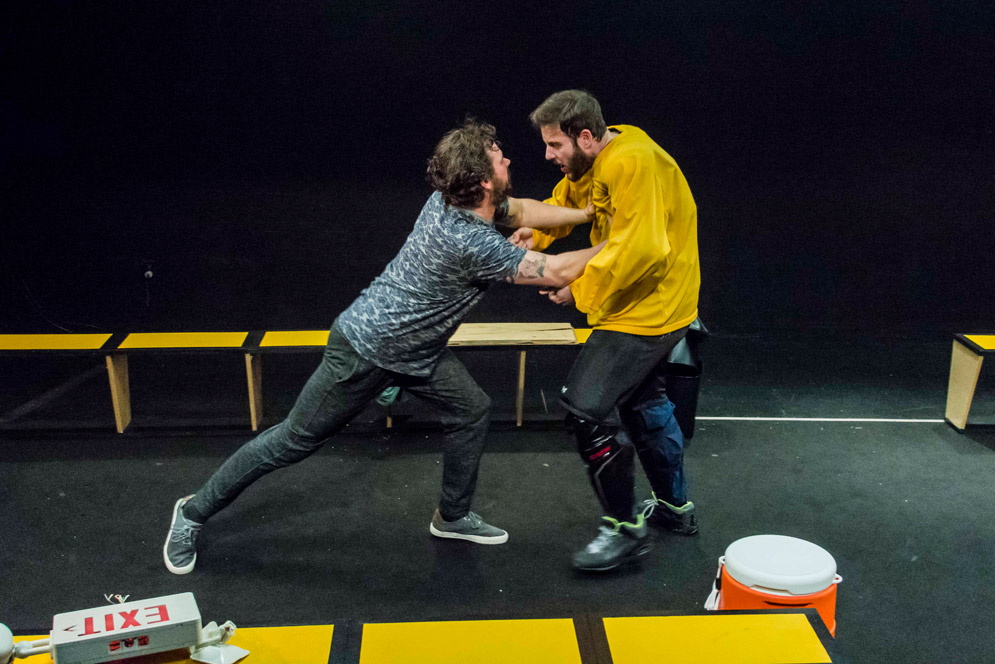 Anthony Goes, as Odie (left), struggles with Greg Maraio, as Moose