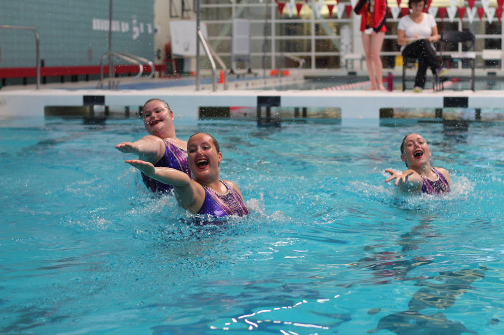 Participants in a BU synchronized swimming meet.